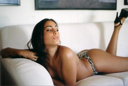 Topless_woman_on_sofa
